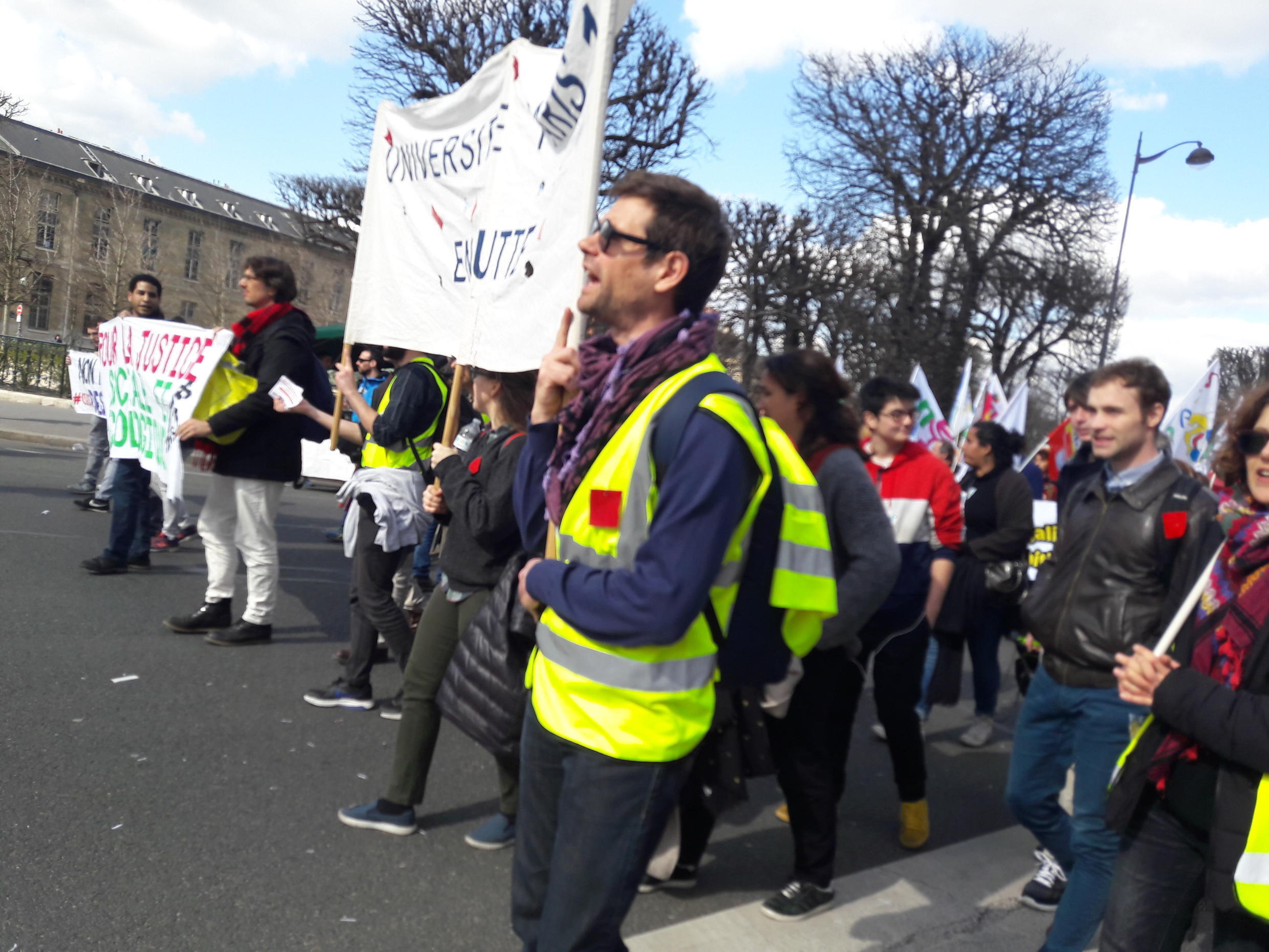 Demonstrators wearing yellow vests joined a trade union march in Paris on Tuesday, 19 March 2019.