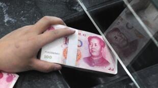 Phương Tây gây sức ép với Trung Quốc về tỷ giá đồng yuan