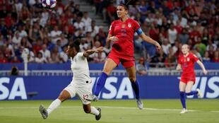 Alex Morgan of the USA scores their second goal against England on their way to the Women's World Cup final, 2 July 2019.
