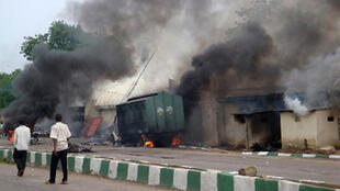 Smoke rises from Maiduguri prison, in Nigeria, after it was set on fire by members of a local Islamic group