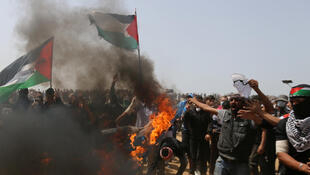 Palestinian demonstrators burn an Israeli flag during protests in Gaza last Friday