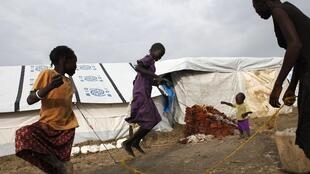 Girls playing at an Internally Displaced Persons camp at the UN base in Malakal, 24 July 2014. It's thought that 1.5 million people have been displaced by fighting.