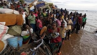 Burundian refugees gather on the shores of Lake Tanganyika in Kagunga village, Kigoma, in western Tanzania on May 17, 2015
