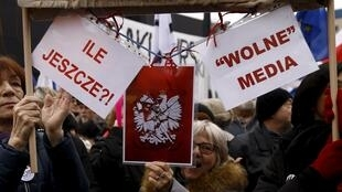 People gather during an anti-government demonstration for free media in front of the Polish television building in Warsaw on 9 Januray, 2016.