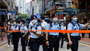2021-07-01T070708Z_1522172593_RC2IBO9AVHD9_RTRMADP_3_HONGKONG-SECURITY