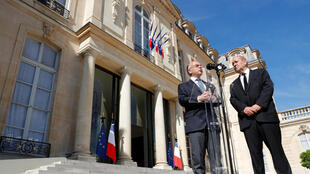 Bernard Cazeneuve and justice minister Jean-Yves Le Drian in the Elysée Palace after the July 18 meeting on security in France
