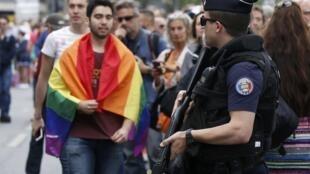 Police at the LGBT Paris Pride parade on Saturday