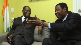 Benin's President Boni Yayi (right) and Alassane Ouattara in Abidjan's Golf hotel, 28 December