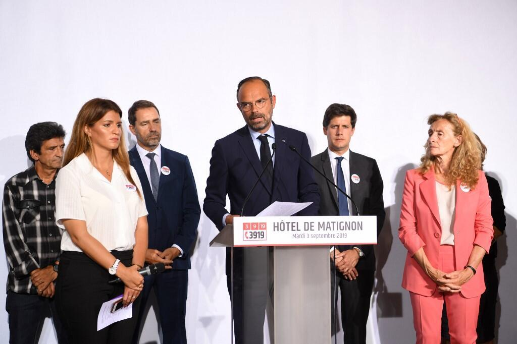 French Prime Minister Edouard Philippe speaks as ministers and the father of a domestic violence victim listen at the launch of a debate on domestic violence, 3 September 2019
