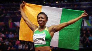 L'Ivoirienne Murielle Ahouré, championne du monde du 60m en salle, le 2 mars 2018 à Birmingham, au Royaume-Uni.