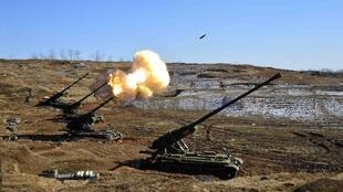 North Korea's artillery sub-units, whose mission is to strike Daeyeonpyeong island and Baengnyeong island of South Korea, conduct a live shell firing drill to examine war fighting capabilities in the western sector of the front line in this picture release