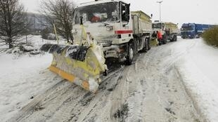Snowploughs on a road near Cambrai, north-west France, on Tuesday