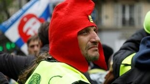 A demonstrator with a Phrygian cap attends a demonstration of yellow vests in Paris, France, May 4, 2019.