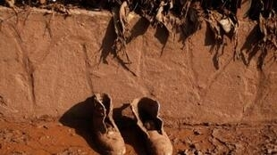 A pair of shoes lies covered with mud in the flooded village of Devecser