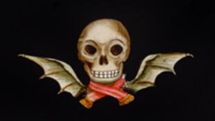 Tête de mort ailée peinte à la main, Grande-Bretagne, seconde moitié du XIXème siècle.