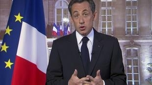Sarkozy on the France 2 television channel speaking to the nation on New Year's Eve