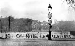"""""""Algerians are drowned here."""" Inscription on the Seine River in October 1961"""