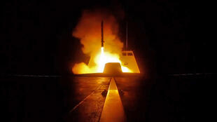 A French defence minstry photo shows a cruise missile being fired from a French military vessel towards Syria