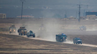Patrulhas russas e turcas no nordeste da Síria, na fronteira com a cidade turca de Kiziltepe,na província de Mardin.01 de Novembro de 2019
