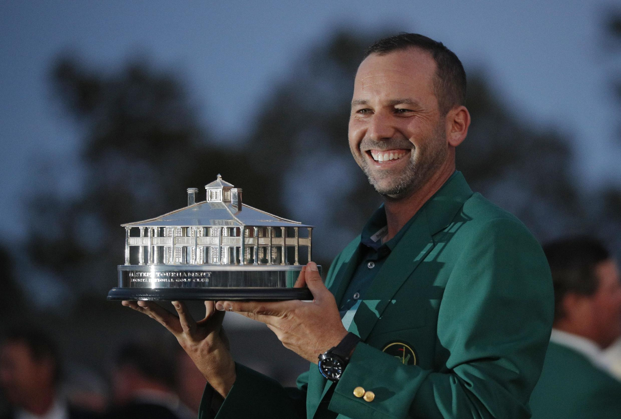 Sergio Garcia holds the Masters trophy after winning the 2017 Masters golf tournament at Augusta National Golf Club in Augusta, Georgia on April 9, 2017.