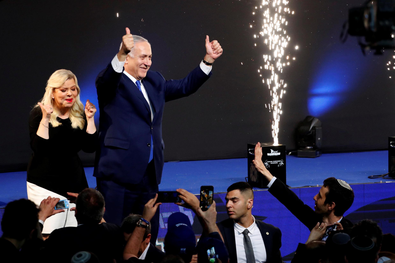 Israel's incumbent prime minister Benjamin Netanyahu next to his wife Sara, in Tel Aviv, 10 April 2019.