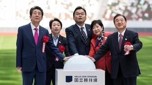 Japan's prime minister, Shinzo Abe, (left) led the dignataries at the opening of the Olympic Stadium in Tokyo.