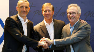 Emmanuel Faber, Chief Executive Officer of Danone, Gregg Engles, Chairman and Chief Executive Officer of WhiteWave Foods Company, and Franck Riboud, Chairman of Danone, pose before the start of a news conference in Paris on July 7, 2016 in Paris.
