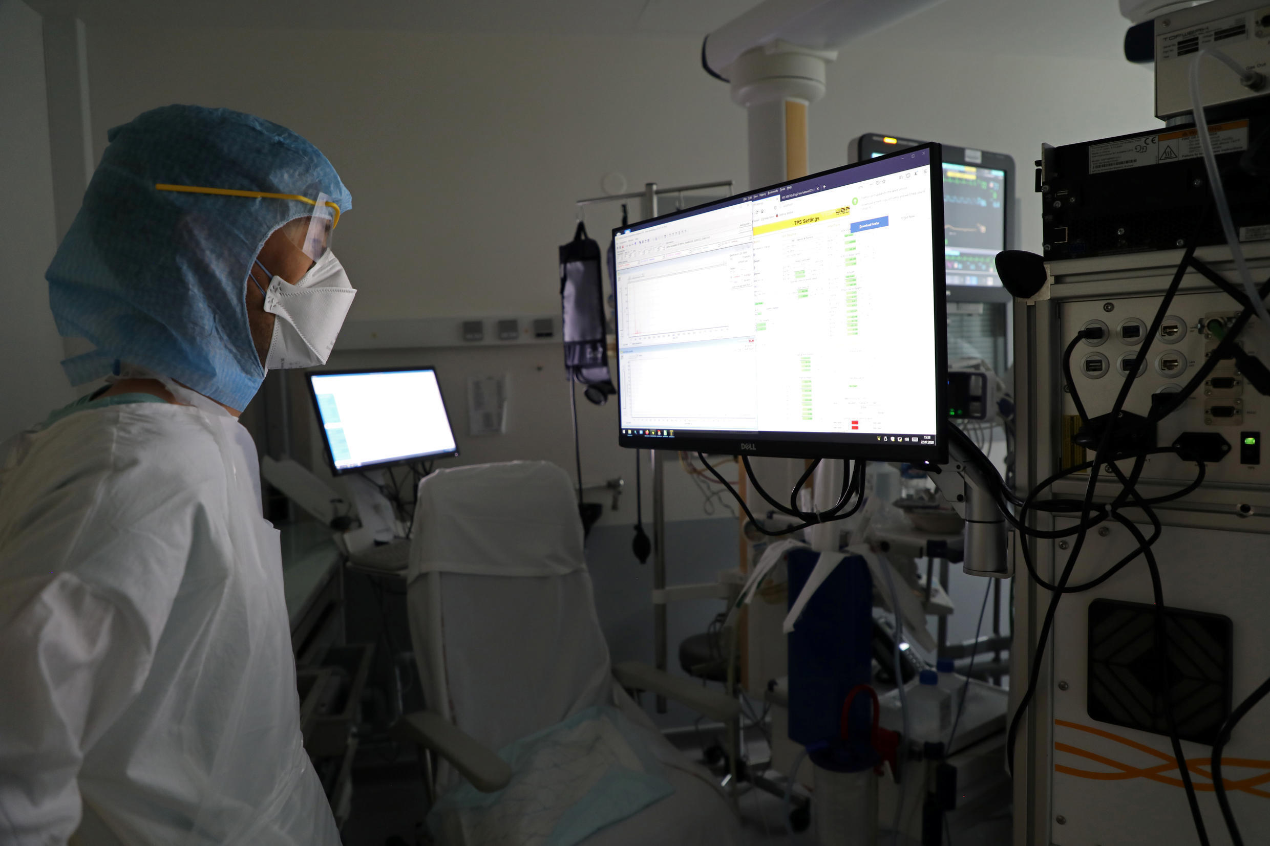 A researcher looks at a screen that is reading molecules detected by the COVID-19 test machine after a patient suffering from coronavirus disease (COVID-19) breathed into the tube at the La Croix-Rousse Hospital in Lyon, France, July 22, 2020. Picture taken July 22, 2020.