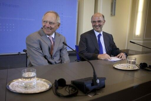 French Finance Minister Pierre Moscovici with his German counterpart Wolfgang Schäuble