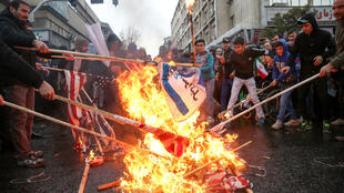 Iranians burn U.S. flags during a ceremony to mark the 40th anniversary of the Islamic Revolution in Tehran, Iran February 11, 2019.