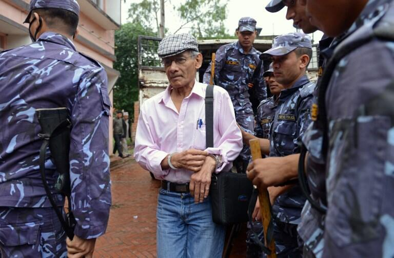 French serial killer Charles Sobhraj being brought to court in Nepal for the murder of Canadian backpacker Laurent Ormond Carriere in 2014