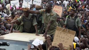 Malian demonstrators cheering soldiers following last week's military overthrow of President Ibrahim Boubacar Keita.