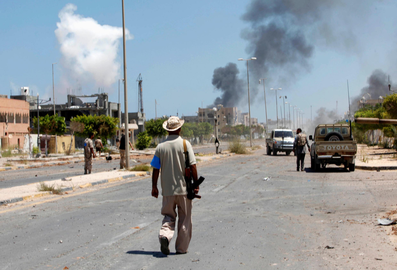 Les forces alliées au gouvernement d'union nationale libyen, dans le quartier Numéro 2 de Syrte, le 16 août 2016.