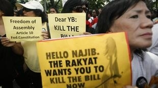 Members from Malaysia's NGO participate in a protest against the Peaceful Assembly Bill