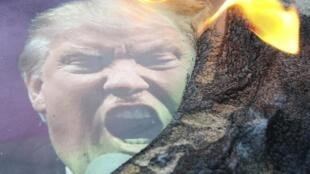 特朗普的一张海报在叙利亚抗议西方轰炸的活动中被焚烧 2018年4月15日