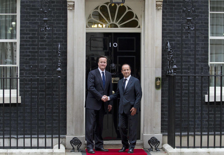 Президент Франции Франсуа Олланд и премьер-министр Великобритании Дэвид Кэмерон на Даунинг Стрит № 10, 10 juillet 2012.