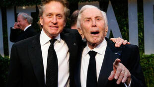 Michael and Kirk Douglas arrive at the 2009 Oscar party