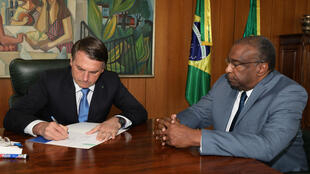 Carlos Alberto Decotelli (R, pictured June 26, 2020 in a handout picture released by Brazilian Presidency press office) had claimed several academic credentials that were vaunted by President Jair Bolsonaro but are accused to be false