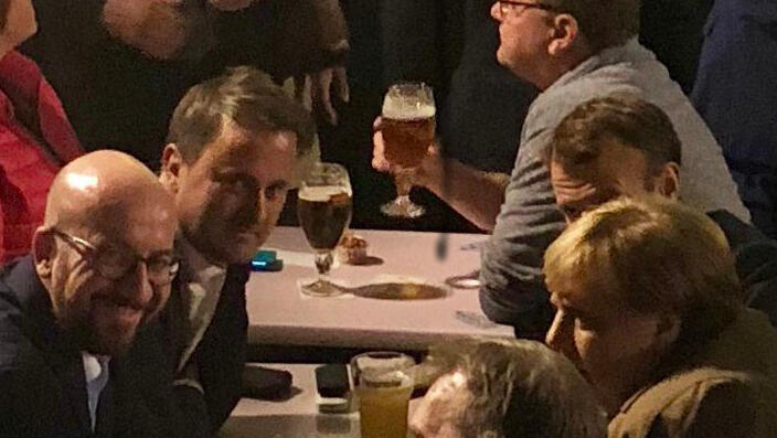 France's Emmanuel Macron, German Chancellor Angela Merkel, Belgian PM Charles Michel and Luxemburg's PM Xavier Bettel were spotted at an informal get-together at a pub in Brussels, (Photo by Hrvoje Kresic, 17 October 2018)