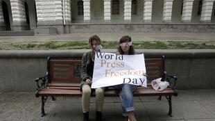 People take part in a flashmob to mark World Press Freedom Day in Tbilisi, 3 May, 2012