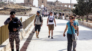 Tourists leave the ruins of the ancient Roman city of Jerash where a Jordanian of Palestinian origin went on a stabbing rampage wounding eight people in November 2019