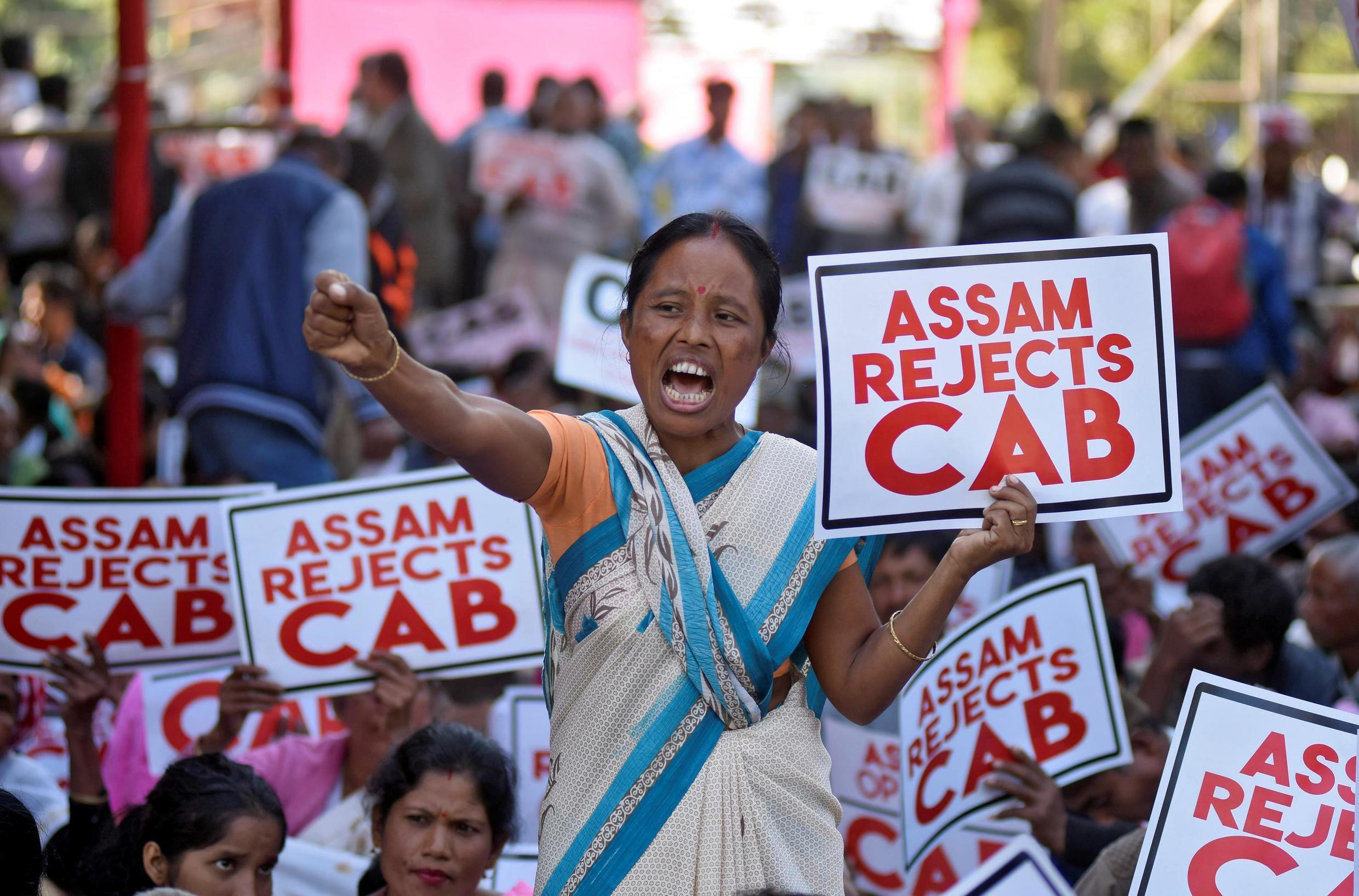 A woman shouts slogans during a protest against the Citizenship Amendment Bill, a bill approved by India's cabinet to give citizenship to religious minorities persecuted in neighboring Muslim countries, in Guwahati, India, December 5, 2019.