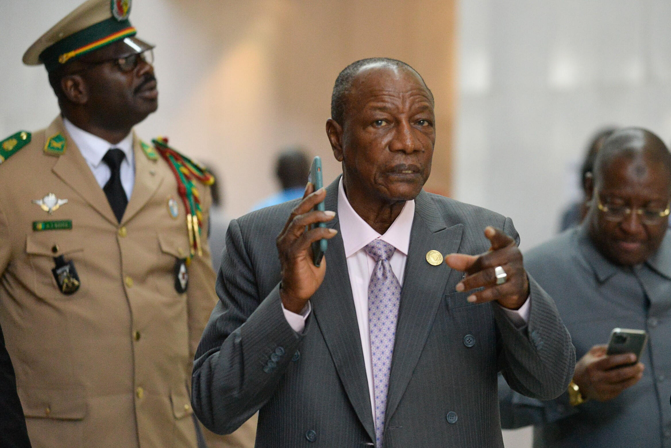 Guinea's President Alpha Conde (center) arrives at the African Union headquarters in Addis Ababa in February 2020 amid opposition at home to a referendum that could extend his rule