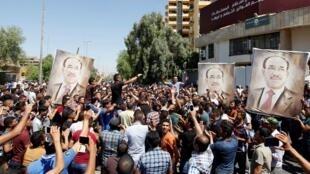 伊拉克总理马利基的支持者在巴格达集会2014年8月11日。