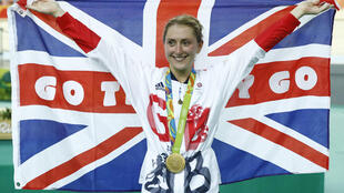 Gold meadallist Britain's Laura Trott poses with a flag on the podium after the Women's Omnium Points race track cycling event at the Velodrome during the Rio 2016 Olympic Games in Rio de Janeiro on August 16, 2016.