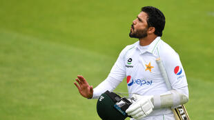 Out for a duck - Pakistan captain Azhar Ali walks off after being lbw for nought to England's Chris Woakes on the first day of the first Test at Old Trafford