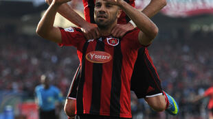 Nuredine Daham et Mohamed Meftah, sous le maillot de l'USM Alger, ici le 14 mai 2013.