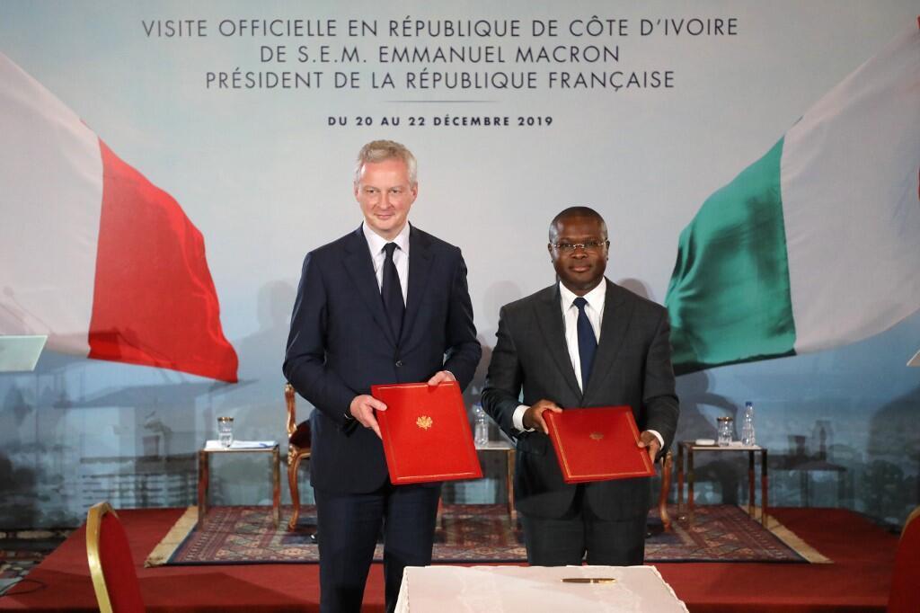 Les ministres de l'Économie français et béninois Bruno Le Maire et Romuald Wadagni à Abidjan lors de la visite officielle d'Emmanuel Macron en Côte d'Ivoire.