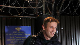 Russian opposition leader Alexei Navalny walks out following his release, after 20 days in jail where he was held on charges of staging an illegal protest last month, in Moscow, Russia October 14, 2018.