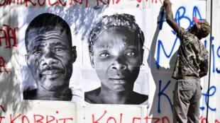 Des graffitis hostiles à l'ONU ont recouvert les murs aux abords de la manifestation du 15 octobre à Port-au-Prince.